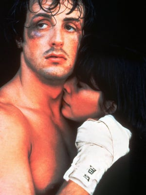 Sylvester Stallone and Talia Shire are shown in a scene from the 1976 film ``Rocky.""