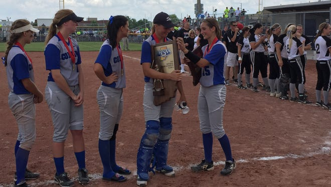 Members of Carroll's softball team accept their Class A state runner-up trophy after a 4-1 loss to Hauser at Ben Davis High School on Saturday.