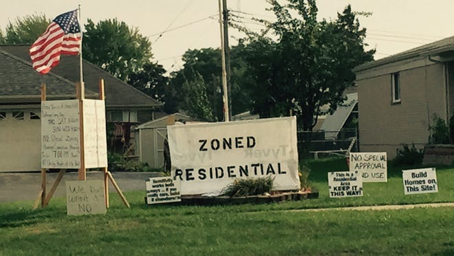 Across the street from a proposed mosque, signs oppose it, on 15 Mile between Ryan and Mound in Sterling Heights, Tuesday, September 8, 2015.  Niraj Warikoo/Detroit Free Press