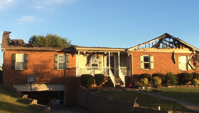 Fire destroyed Brandon and April Gourley's Maxie Jones Road home near White House Saturday, but  their dog was saved by an off-duty Nashville firefighter they'd never met.