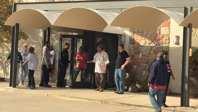 Workers arrive to vote at UAW Local 140 in Warren on Tuesday on a proposed four-year contract with Fiat Chrysler Automobiles.