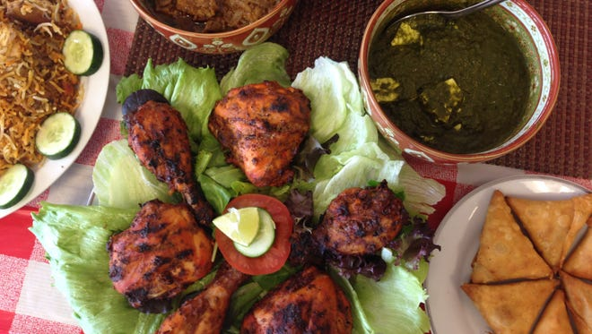 Tandoori chicken, center, and biryani rice, left, are among the offerings at India Fest on Saturday