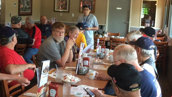 William Udulutch, a volunteer van driver for disabled veterans, speaks June 22 to the Veterans Weekly Cup-of-Coffee group at Denny's in Rothschild.