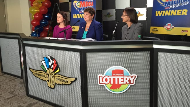 Lauren Littlefield, a marketing representative for the family and Hoosier Lottery representatives attending the Hoosier Lottery news conference on July 29, 2016.
