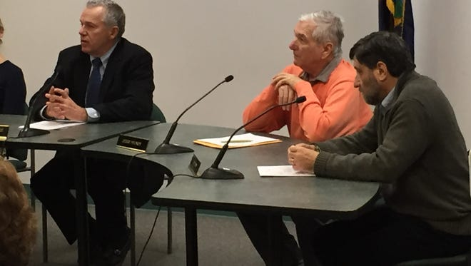 Shelburne Selectboard Chairman Gary von Stange (left) announces the board's agreement with member Josh Dein as Jerry Storey (center) and Dein (right) listen.