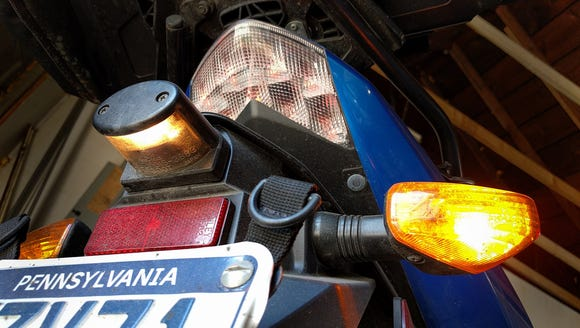 My Kawasaki Z750 with a manually operated turn signal.