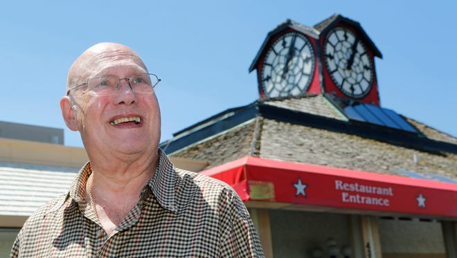 Roy Meeks, owner of the Best Western hotel, discusses the history of the iconic clock above the Hour Time restaurant Thursday, May 19, 2016, at 4343 South Street in Lafayette. Meeks said the clock was placed above Hour Time restaurant in 1979. Meeks said the clock was built in Leicester, England in 1910. The clock was once above the Rochdale train station, also in England.