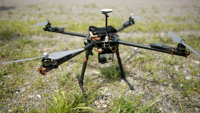 The drone that the Wood County Sheriff's Department purchased sits on the ground before a demonstration behind the South Wood County Recreation Center in Wisconsin Rapids, Wednesday, July 1, 2015.