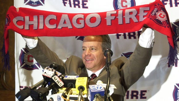 Dave Sarachan holds up a Chicago Fire scarf on  Monday, Nov. 4, 2002, in Chicago when he was announced as the new head coach for the MLS team. Sarachan replaced Bob Bradley, who had resigned.