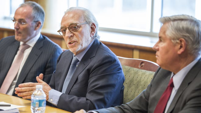 Trian Partners CEO Nelson Peltz speaks at The News Journal offices in New Castle on March 30 as company Chief Investment Officer Ed Garden, left, and former Rockwood Holdings Inc. executive Robert Zatta look on. Peltz is seeking to add four nominees to the DuPont Co. board.