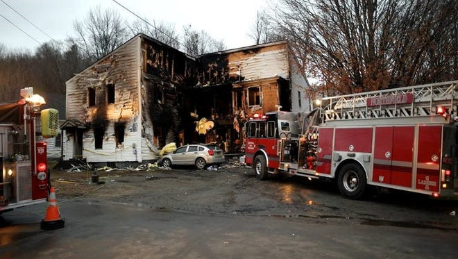 """A fire that police are calling """"suspicious"""" killed one person and left another in critical condition broke out in this apartment building early Monday in Northfield."""