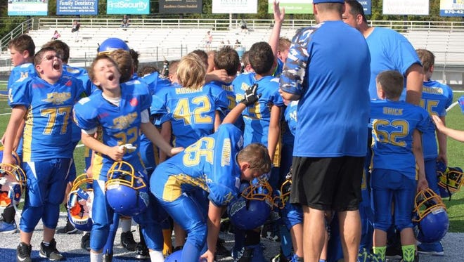 Members of the Mountain Home Pilots celebrate a victory earlier this season.