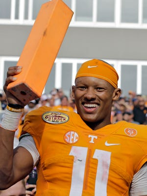 Tennessee quarterback Joshua Dobbs smiles as he holds a pylon after the Vols' 45-6 win over Northwestern in the Outback Bowl on Jan. 1, 2016.