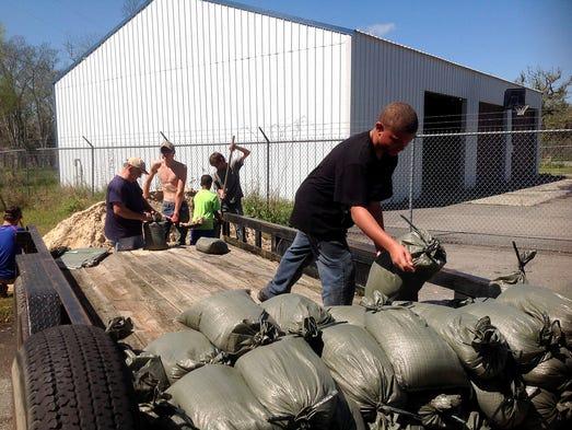 Elajuh Rains helps load sandbags on Sunday, March 13,