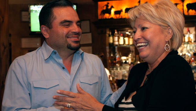 Isabella Solis is congratulated for winning the Dona Ana County Commission District 4 seat by her supporter Darrell Rubio at Cattle Baron, June 7,2016.