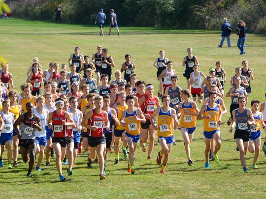 The varsity boys field starts to climb the first hill at the Racine Case Eagle Invitational cross country meet Saturday at UW-Parkside.