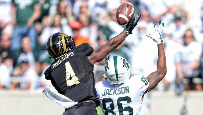 Western Michigan Broncos cornerback Darius Phillips (4) breaks up a pass intended for Michigan State Spartans wide receiver Trishton Jackson (86) during the first quarter of a game at Spartan Stadium.