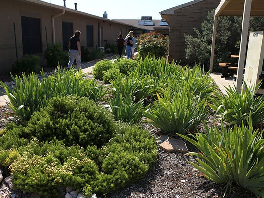 Residents maintain a lush garden they helped create at the Concho Valley Community Corrections Facility Wednesday, May 23, 2018.