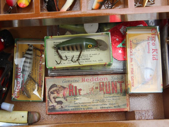 Vintage fishing lures fill a tackle box owned by Mike