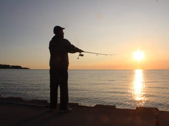 Patrick Castillo of Greenfield casts while fishing on Government Pier on Milwaukee's Lake Michigan shore.