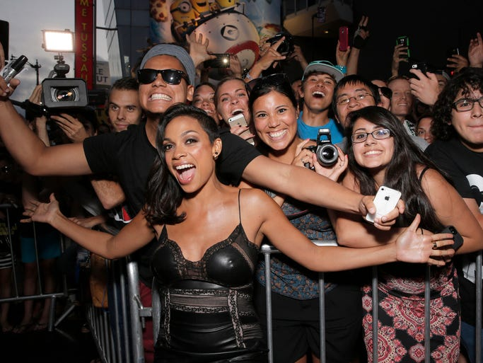 "Rosario Dawson poses with fans at the Los Angeles premiere of ""Sin City: A Dame To Kill For"" at the TCL Chinese Theatre on Tuesday, Aug. 19, 2014 in Los Angeles. (Photo by Todd Williamson/Invision/AP)"