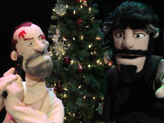 "Bruce Willis' John McClane (left) and Alan Rickman's Hans Gruber, as re-created in All Puppet Players' ""Die Hard: A Christmas Story."""