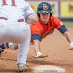 Auburn's J.J. Share dives back to first base against College of Charleston's Nick Pappas in the eighth inning of the Tallahassee Regional on Friday. College of Charleston defeated Auburn 7-6 in 11 innings.