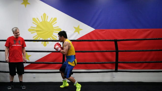 Trainer Freddie Roach watches Manny Pacquiao shadow-box during a workout at Wild Card Boxing Club on Monday in Los Angeles. Pacquiao is scheduled to fight Floyd Mayweather Jr. in Las Vegas on Saturday.