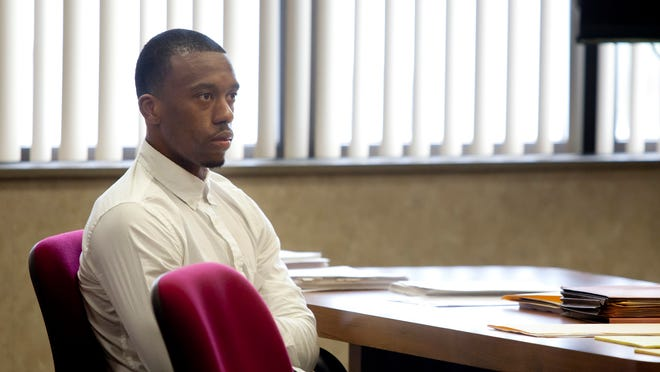 Tevin Sutton, 24, of Port Huron, listens Tuesday as opening statement are delivered during his trial in the courtroom of Judge Daniel Kelly at the St. Clair County Courthouse. Sutton is charged with two counts of assault with intent to commit murder; one count of controlled substance, second offense; a count of fleeing a police officer; two counts of assault with a dangerous weapon, felonious assault; and one count of assaulting, resisting or obstructing a police officer.