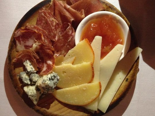 Meat and cheese plate at Pamplona.