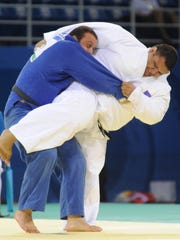 In this file photo, Ricardo Blas Jr., right, battles Lasha Gujejiani of Georgia in preliminary men's +100 kilogram judo at the Beijing 2008 Olympic Games.