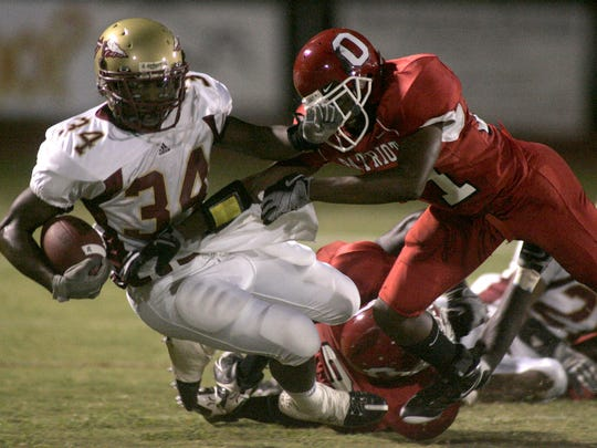 Oakland's Deion Wade takes down Riverdale's Trey Oliver during a 2008 Battle of the Boro contest.