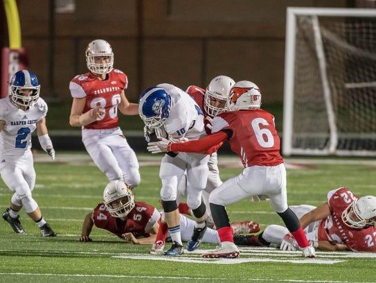 Harper Creek's Dawson Bartlett advances the ball during