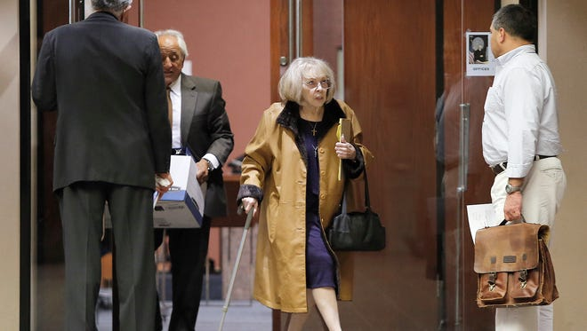 Lisbeth Garrett leaves the 168th District Court on Friday during her murder trial in the 1977 death of her husband, U.S. Army Maj. Chester Garrett.