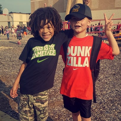 Nolan Pratt, right, and his friend Shemiahh Turner on their first day of third grade at McKinley Elementary School in Stevens Point.