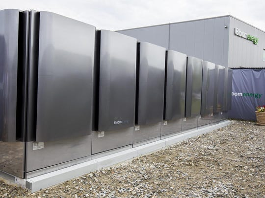 Energy servers sit outside of the Bloom Energy factory in Newark. The company recently announced that it has refined its servers to generate the same energy output in half the footprint, while using less fuel.