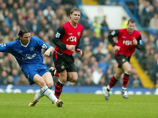 FILE In this Saturday Oct. 23, 2004 file photo Chelsea's Alexei Smertin, left, in action during the English Premiership League soccer match against Blackburn Rovers at Stamford Bridge, Chelsea, London. Former Chelsea midfielder Alexei Smertin has been put in charge of investigating soccer racism in Russia. (AP Photo/John D McHugh, File)
