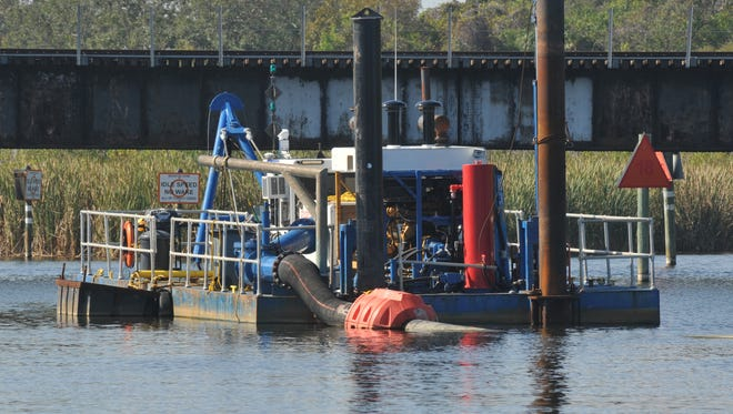 A dredging boat and equipment on Turkey Creek in Palm Bay.