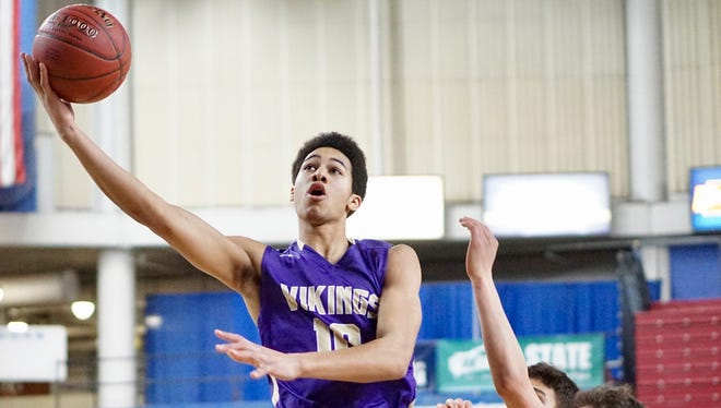 North Kitsap's Kai Warren scored 20 points in the Vikings' 69-60 loss to Anacortes in the Class 2A boys state tournament Saturday at the Yakima SunDome.