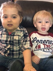 Matthew Addison, right, sits with his sister, Ahnna