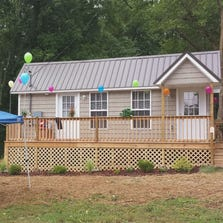The first microhouse to open in Rehea Co. neighborhood.