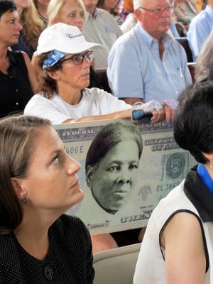 A woman holds a sign supporting Harriet Tubman for the $20 bill during a town hall meeting at the Women's Rights National Historical Park in Seneca Falls, N.Y. on Aug. 31, 2015.