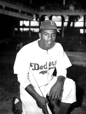 "In this April 11, 1947 file photo, Jackie Robinson of the Brooklyn Dodgers poses at Ebbets Field in the Brooklyn borough of New York. Robinson is the subject of a two-part documentary, ""Jackie Robinson"" directed by Ken Burns, Sarah Burns and David McMahon."