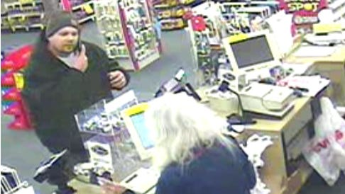 Dearborn police are asking for help in identifying a suspect caught on surveillance tape robbing a CVS store.