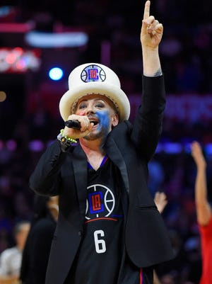 Singer Boy George tries to fire up the crowd during taping of a Celebrity Apprentice episode in the first half of an NBA basketball game between the Los Angeles Clippers and the Phoenix Suns, Monday, Feb. 22, 2016, in  Los Angeles.