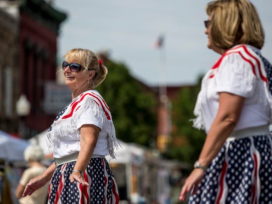Pam Richardson, of Warren, dances along with other members of the Cruisin' USA Line Dancers during the annual Bologna Festival Friday, July 29, 2016 in Yale.