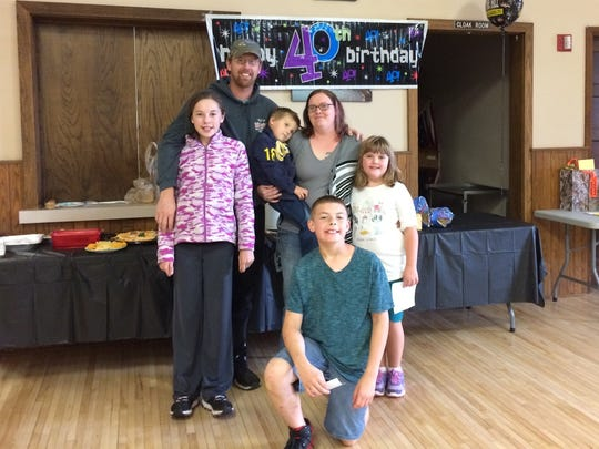 Andy Stuth poses with his children Randon, Zoey, Kaylee and Jarrod, and wife Keona, at his 40th birthday party.