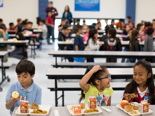 Students eat lunch in the cafeteria Thursday, Oct.