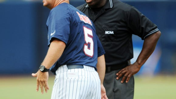 Mississippi head coach Mike Bianco, left, appeals for help while arguing a call with second base umpire Harry Greer against Washington during an NCAA college baseball regional game at Oxford-University Stadium on Monday, June 2, 2014, in Oxford, Miss. (AP Photo/Oxford Eagle, Bruce Newman) NO SALES.