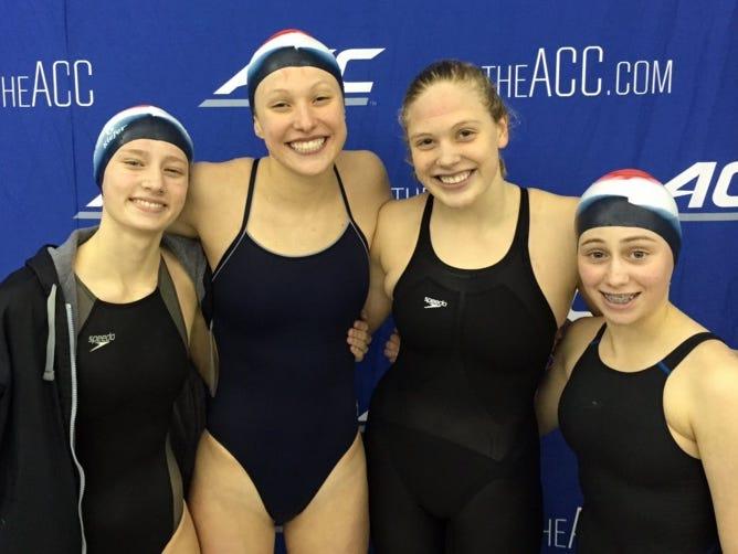 The Carolina Day girls won the NCISAA 1-A/2-A swim meet held Monday in Greensboro.